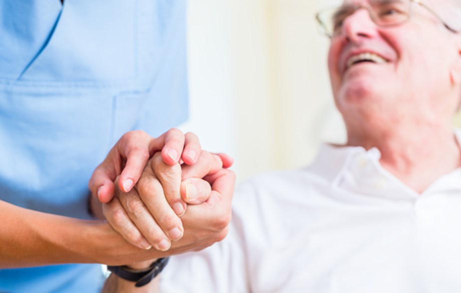 Old man holding hands with nurse